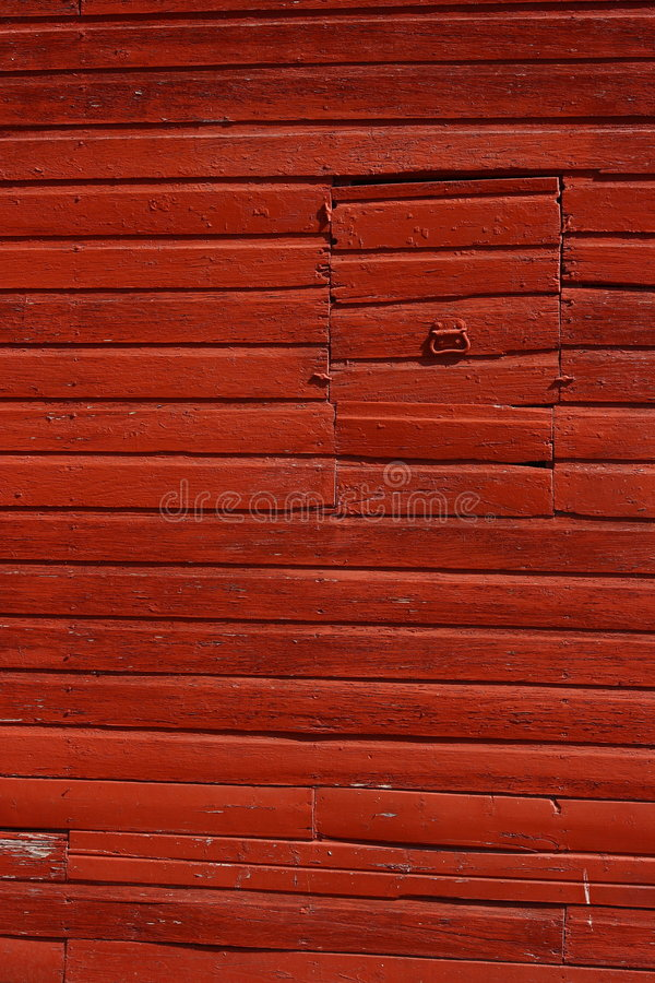 Red Barn. A close-up photo of the side of an old red barn stock image