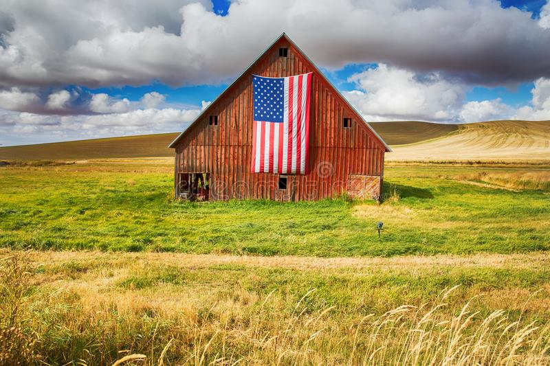 Red Barn with American flag stock image