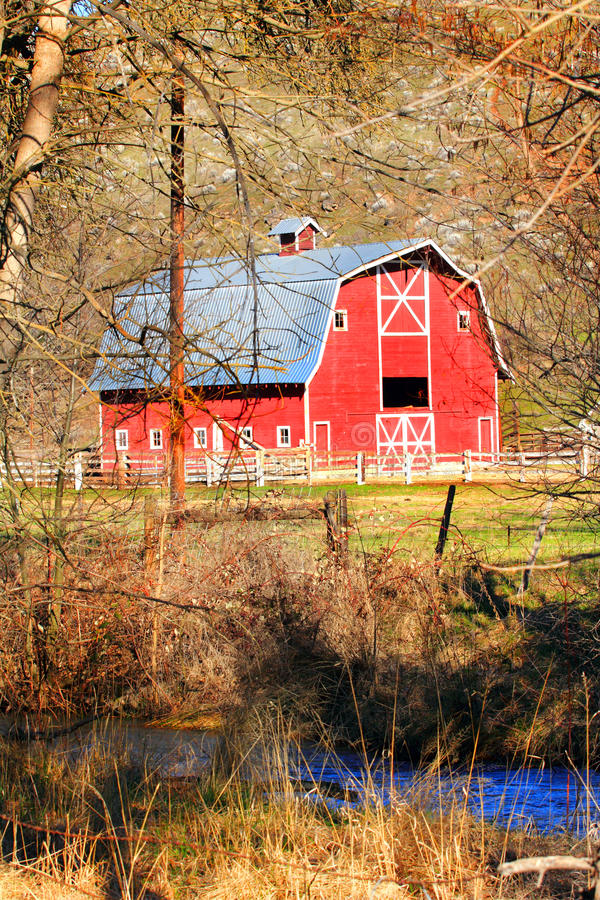 Red Barn and Creek stock photo