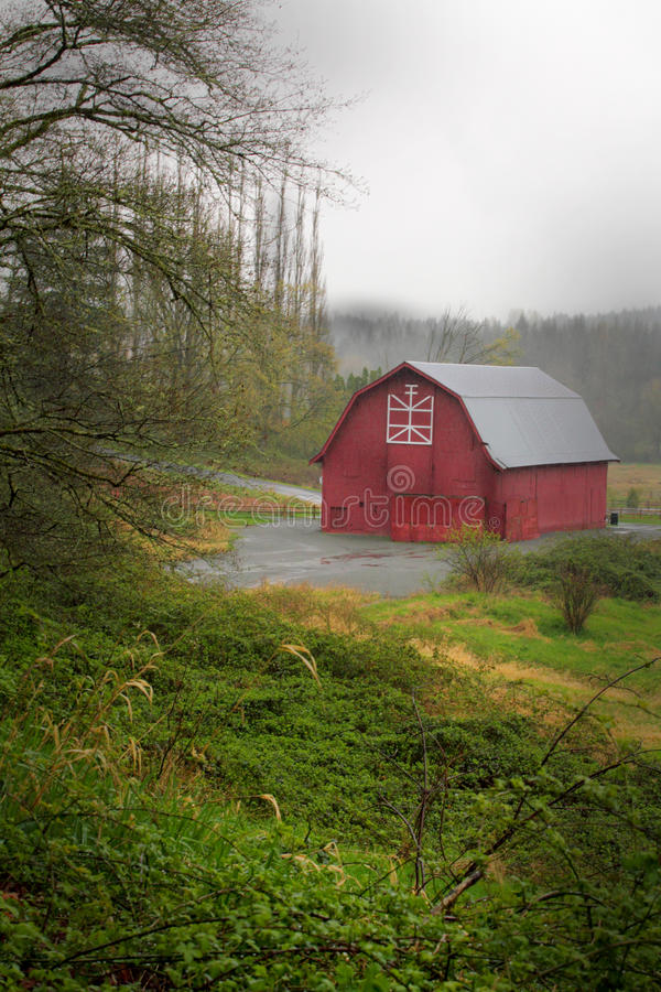 Download Red Barn in Rain stock photo. Image of railing, farm - 30474694