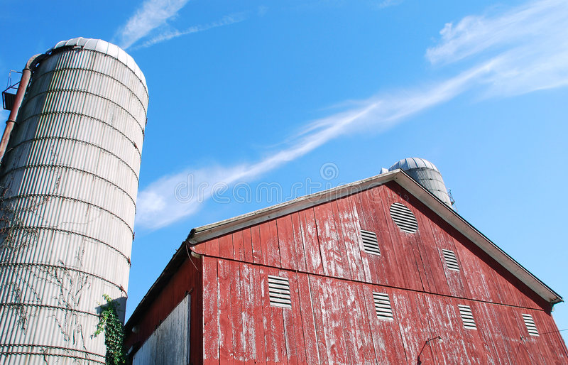 Red barn and silo. Family farm, with weathered red barn, two silos. Barn built in 1872. Located in rural Pennsylvania stock photography
