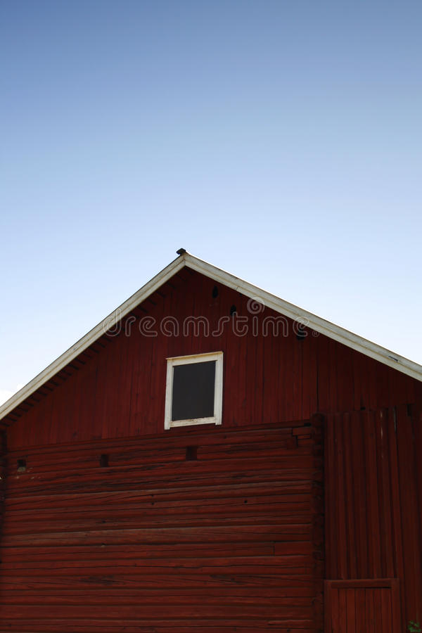 Red barn under the sky stock image