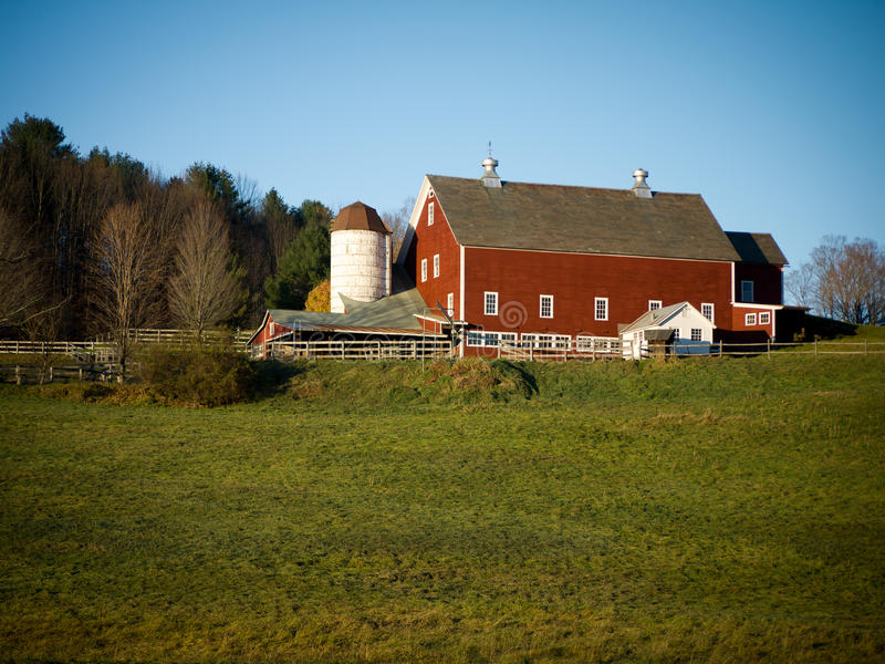 Red Barn with White Silo Sunset royalty free stock photography