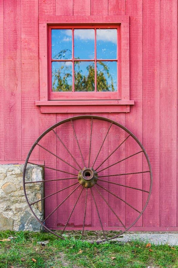 Red Barn, Window and Wagon Wheel stock photo
