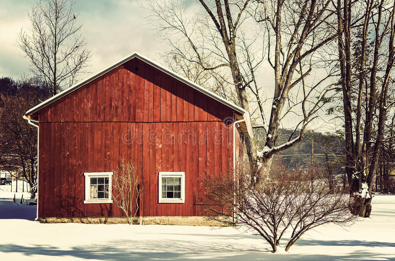 Red barn in winter. AN old red barn in the winter time. Fresh snow royalty free stock image