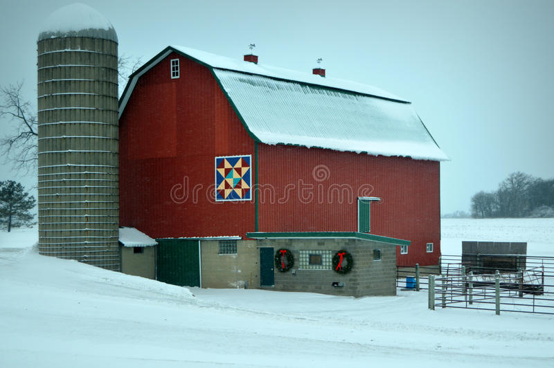 Red Barn in Winter. One of Walworth County's famous red quilt barns located on Highway 50 in Bloomfield Township located in Wisconsin. A beautiful red barn with royalty free stock photography