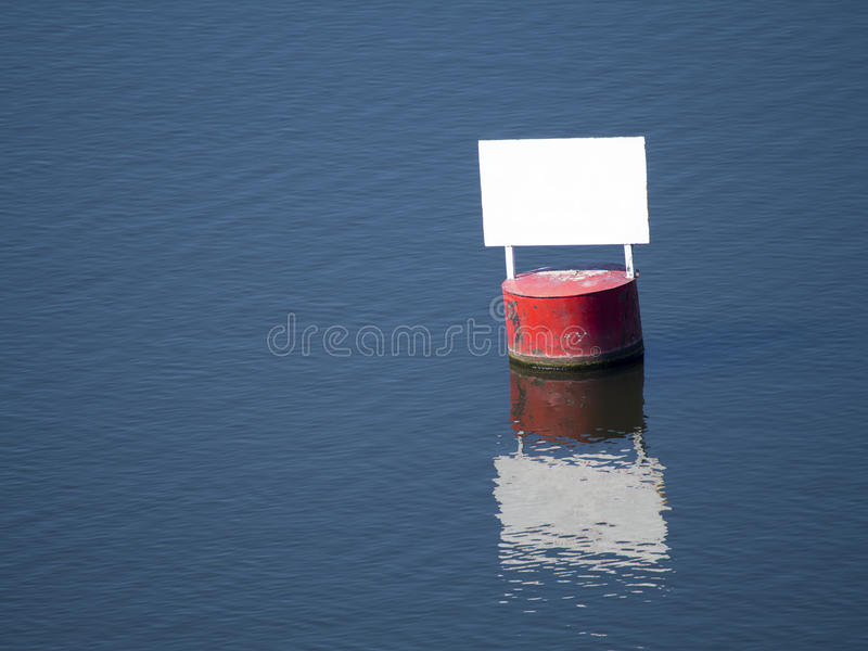 Red barrel with a white panel clears stock photo