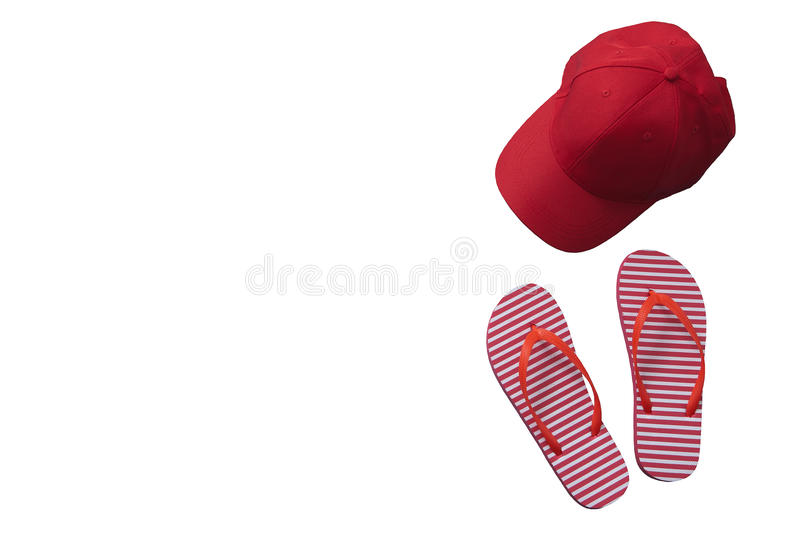 Red baseball cap isolated on white background. Striped flip flops. Mock up and summer. stock image