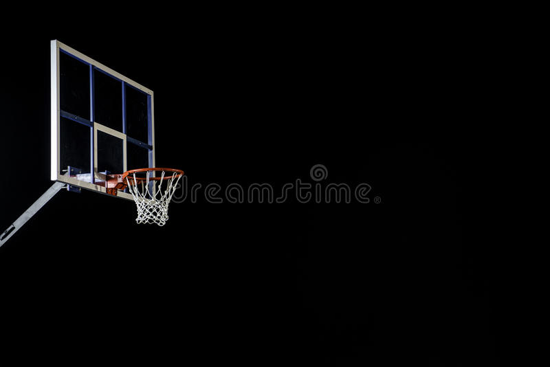 Red basketball hoop on black. Basketball ring. With copy space. royalty free stock photos