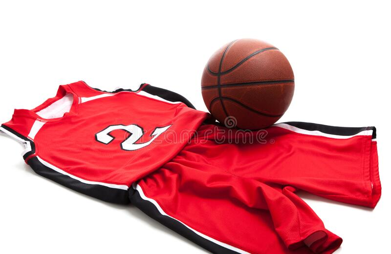 Red basketball uniform on white background with leather ball royalty free stock photo