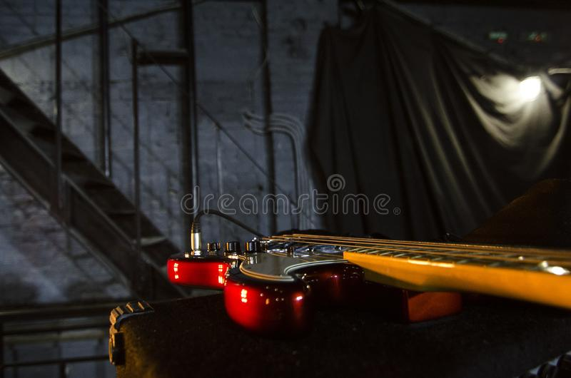 Red bass guitar close-up. Music instruments. Macro. royalty free stock images