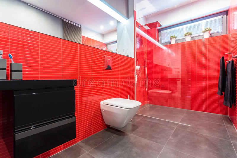 Red bathroom with toilet. Modern bathroom with red tiles with toilet and cabin stock photography