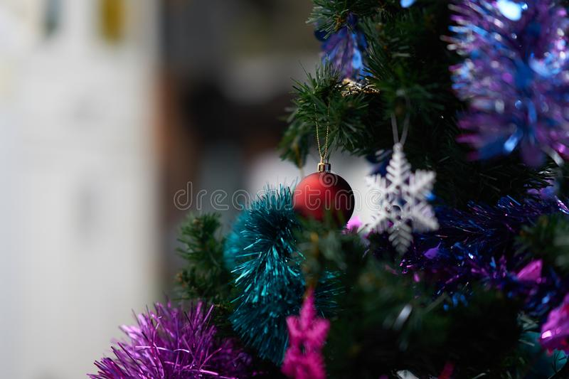 Red bauble decor on christmas tree with colorful snowflake royalty free stock image
