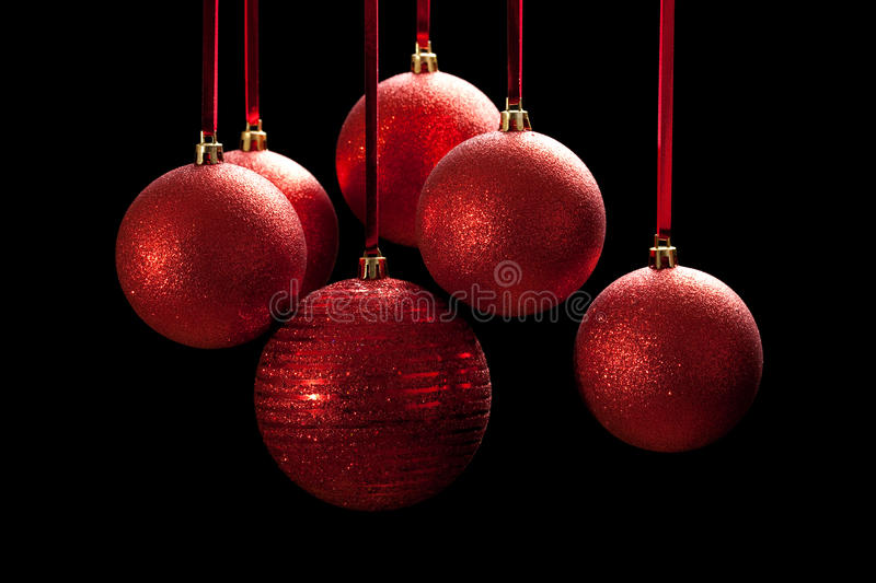 Red baubles on black background royalty free stock photography