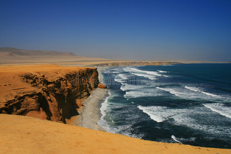 Red beach in Peru. The beautiful red beach in the Paracas nature reserve in Peru, South America royalty free stock images