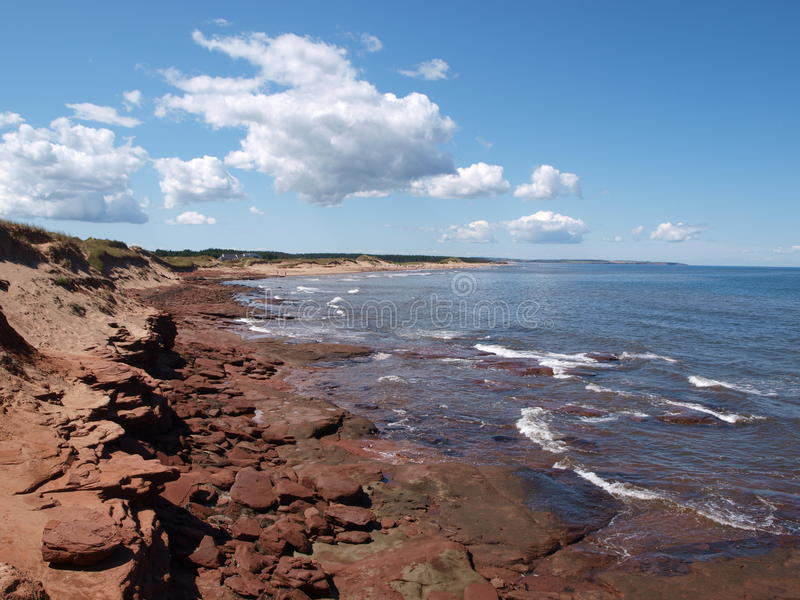 Red beach of Prince Edward Island, Canada. Red beach and stones of Prince Edward Island, Canada stock photos