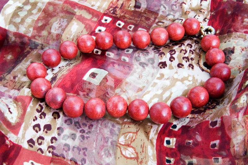 Download Red Bead Necklace On A Silk Scarf Stock Image - Image: 13316909