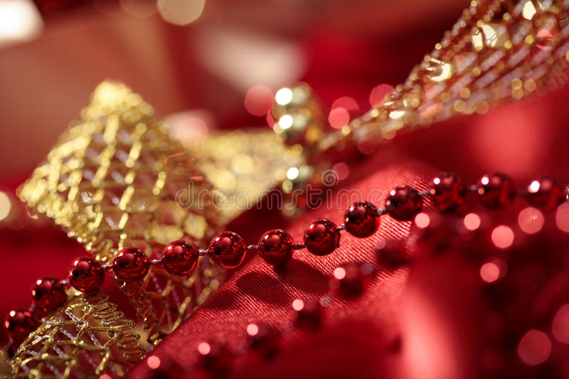 Red beads close-up on blurred lights bokeh holiday background royalty free stock images