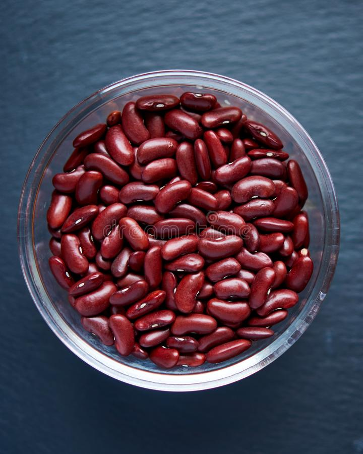 Red bean in a bowl on dark background. Beans red on a dark background close-up. stock photos