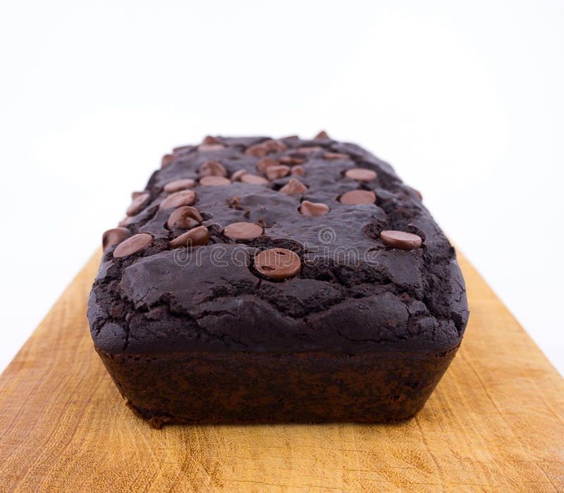 Red bean brownie loaf with chocolate chips on wooden cutting board stock image