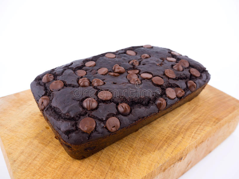 Red bean brownie loaf with chocolate chips on wooden cutting board stock photos