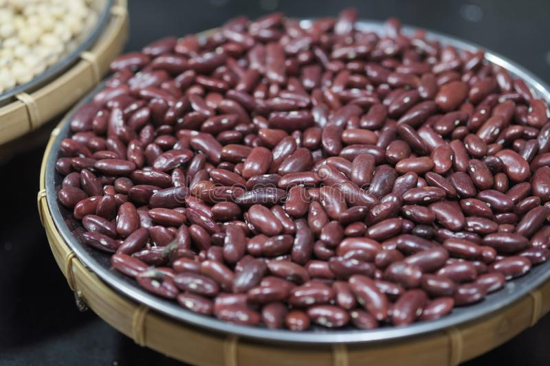 Red bean seeds. The texture of the legumes. Close up red beans background, seeds of red beans stock photography