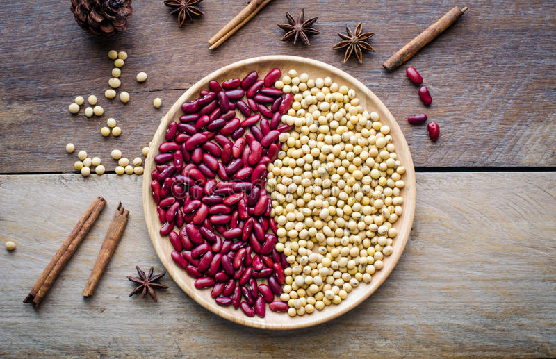 Red beans and soy beans in dish on wooden table. royalty free stock image
