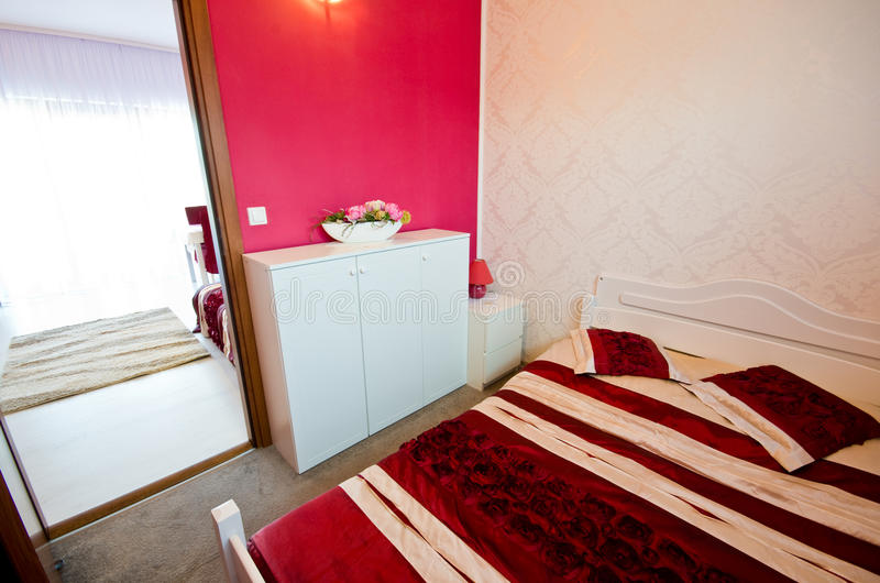 Red bedroom stock photography