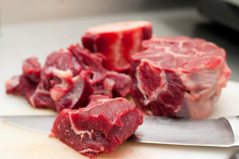 Red beef. And metalic knife royalty free stock images