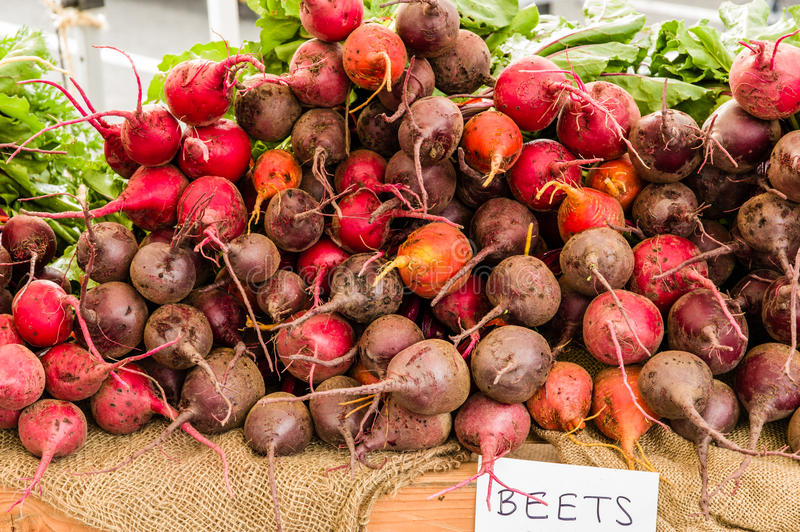 Red beet roots at the market. Display of red beets at the farm market stock photos