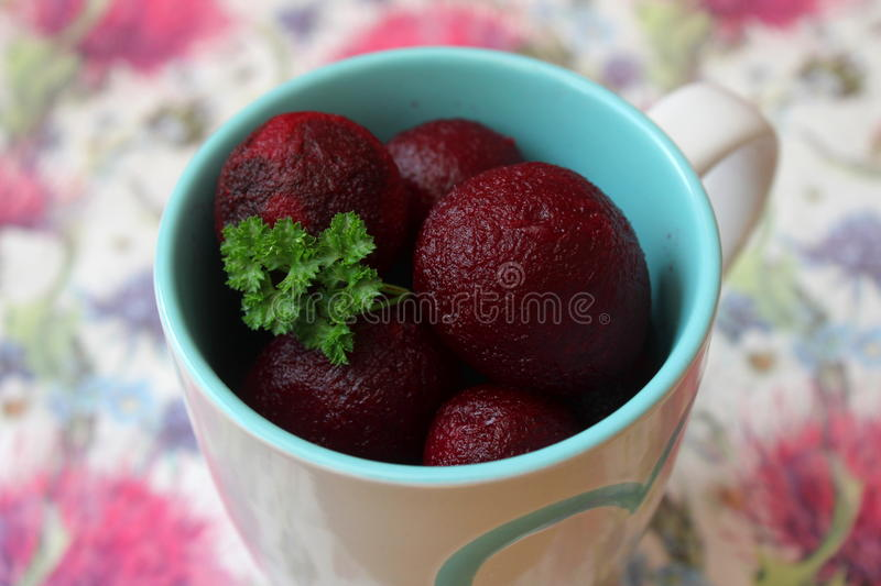 Red beet roots. A snack of red beet roots stock photos