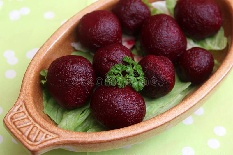 Red beet roots. A snack of red beet roots stock photo