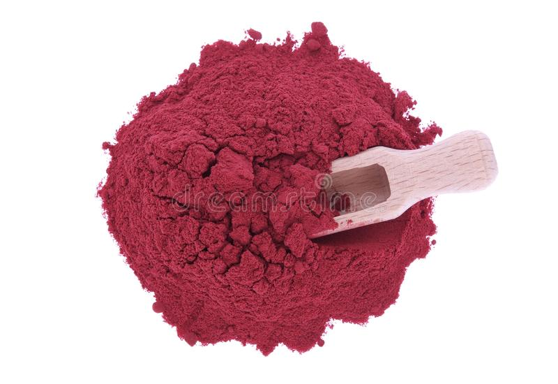 Red beetroot powder and wooden spoon. Red beetroot powder isolated on white background stock image