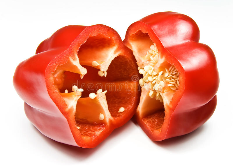 Red bell pepper. Red capsicum (bell pepper) shopped in half royalty free stock photography