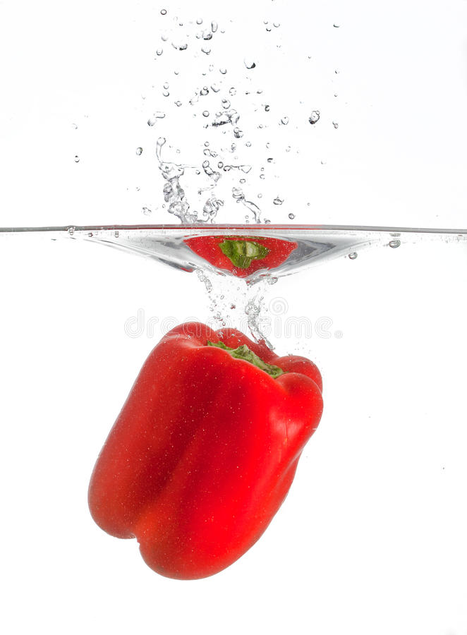 Bell pepper splash. A red bell pepper falling in water with a splash stock photography