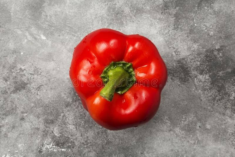 Red bell pepper on gray background. Top view. Food background.  stock photo