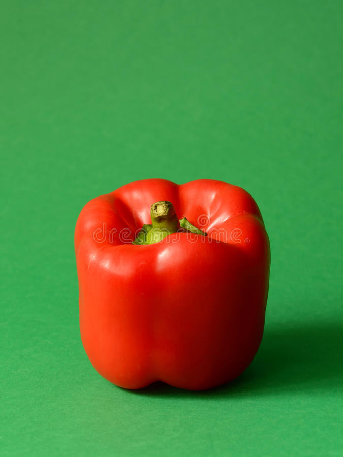 Red Bell pepper. On a green background royalty free stock photography
