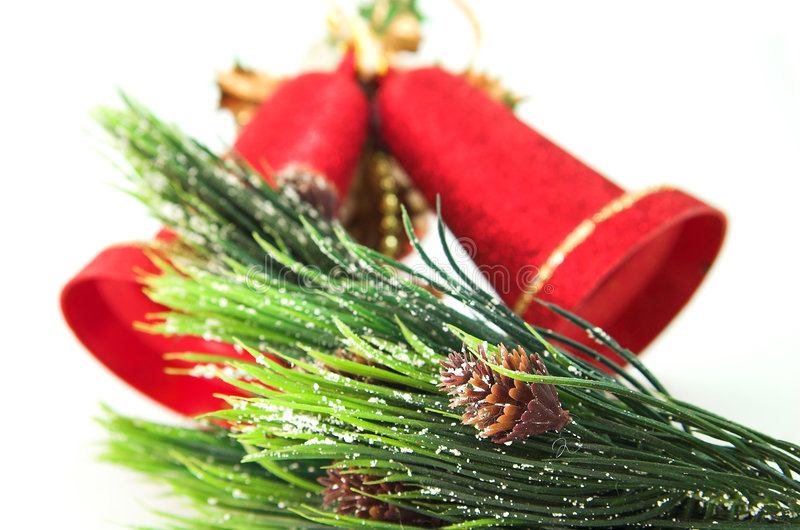 Red bells and christmas tree royalty free stock image