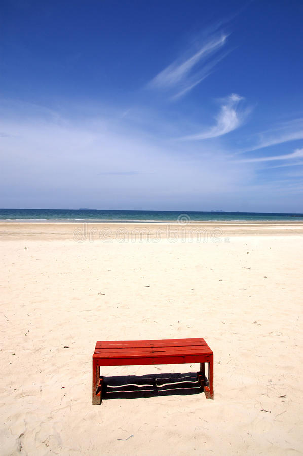 Red bench on the beach royalty free stock images