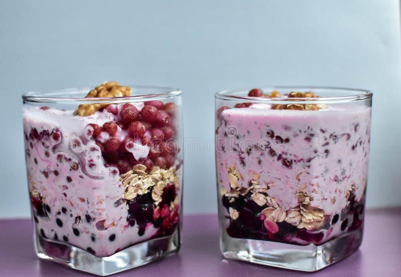 Red berries, black berries, blueberry, breakfast, smuz, porridge with berries, a healthy breakfast, the athlete`s breakfast, porri. Dge with kefir and berries stock image