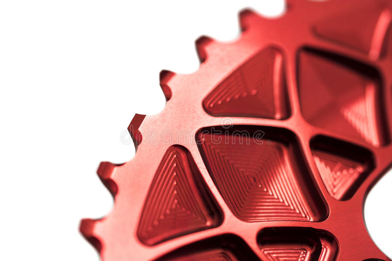 Red bicycle chainring in hand royalty free stock photography