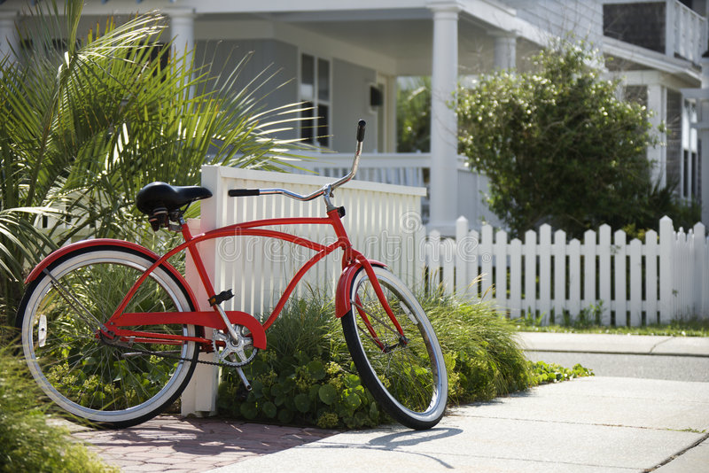 Red bicycle in front of house. royalty free stock photography