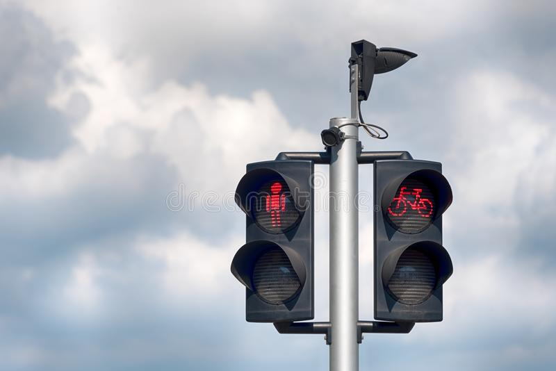 Red bicycle and pedestrian traffic lights. Red traffic light for bikes, city background. Red bicycle and pedestrian traffic lights. Red traffic light for bikes royalty free stock image