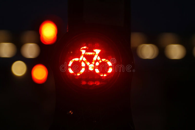 Red bicycle traffic light stock photo