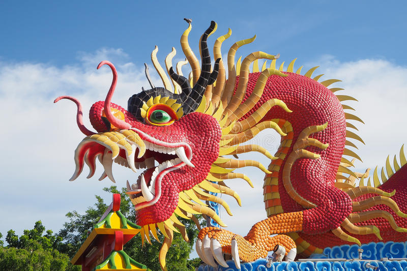 Red big dragon statue in public place of worship. Chonburi province, Thailand stock image