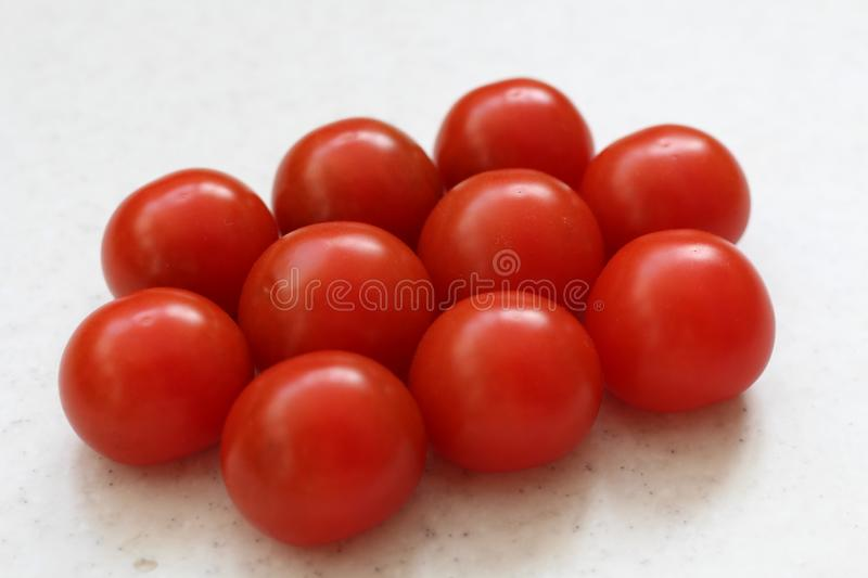 Red big tomatoes stack isolated on table stock photos