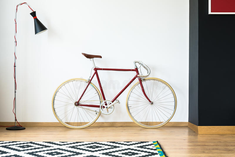 Red bike in living room stock photo. Image of modern - 98975660