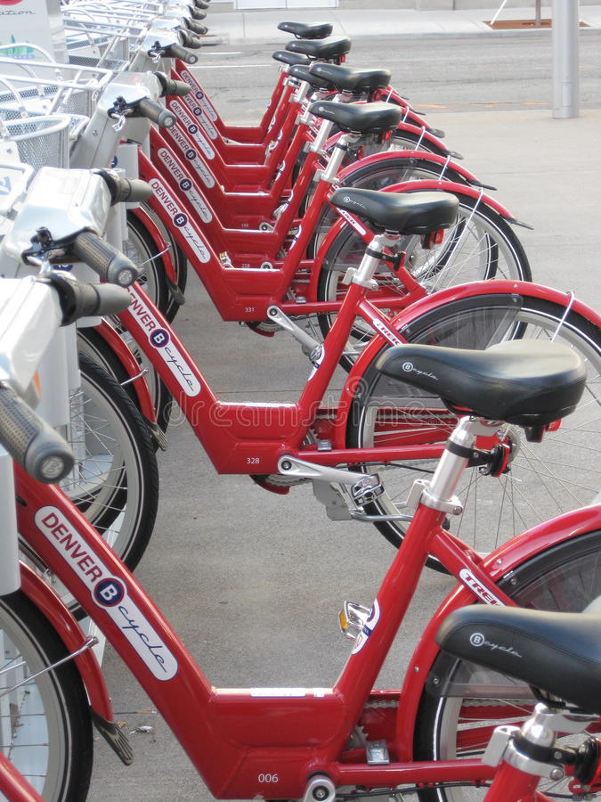 Red Bikes. Rows of red bikes that are used for rentals to get around Denver are both useful for fun and exercise but also good for the environment as it saves on stock photos
