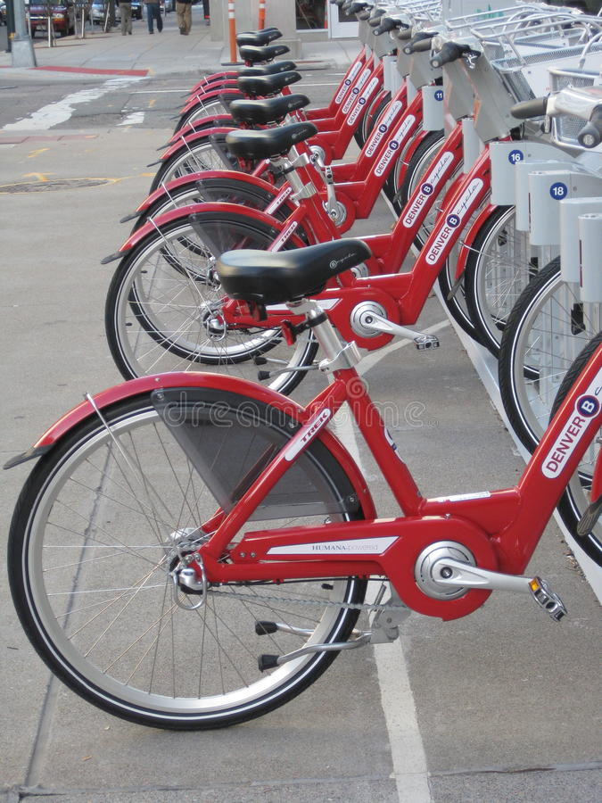 Red Bikes. Rows of red bikes are lined up for rental purpose in downtown Denver as a way of getting around the city while also getting exercise. It also saves on royalty free stock photography