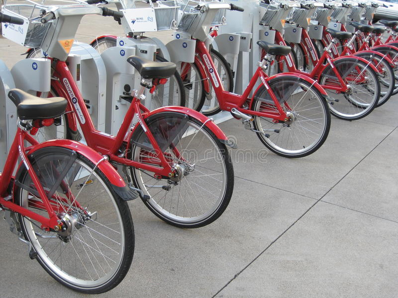 Red Bikes. Rows of red bikes are ready to be rented and used to explore the downtown city of Denver without the hassle of parking and driving a car in the city royalty free stock photos